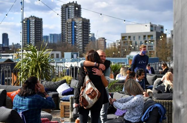 Hugs, with caution: UK PM Johnson eases England's lockdown