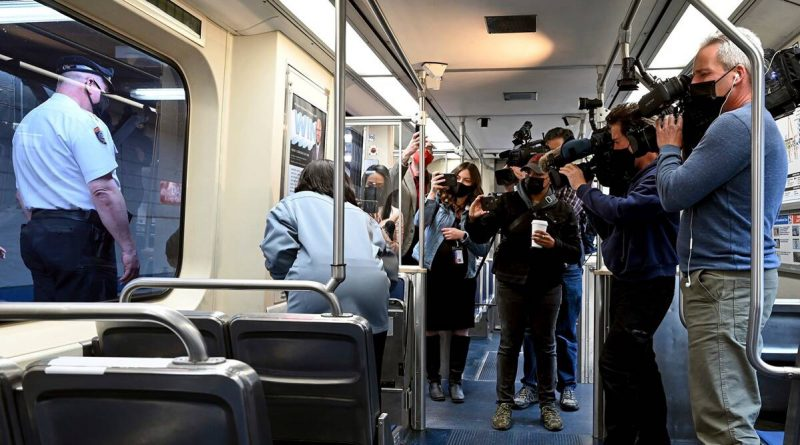 US train riders held up phones as woman was raped, police say